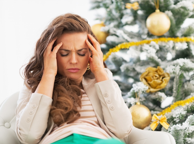 how to cope with stress during the holidays - woman stressed sitting next to christmas tree - victory addiction recovery center