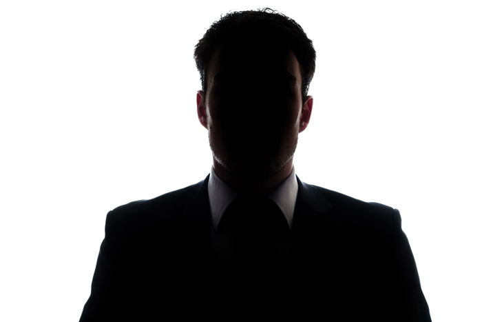 Addiction Treatment for Professionals: How To Stay Discreet - silhouette of businessman - victory addiction recovery center