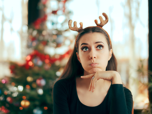How to Survive the Holidays in Recovery - woman bored at christmas party