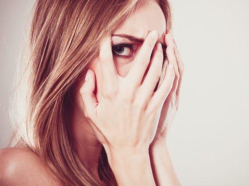 Are You Afraid of Getting Sober? - afraid woman peeking through her fingers