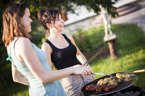 Fun in the Sun While Staying Sober - two women at a cookout