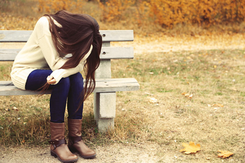 How to Know If You've Hit Rock Bottom - distraught girl on park bench