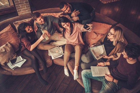 Can-a-Taste-of-Independence-in-College-Lead-to-Addiction - friends studying and hanging out in loft apartment