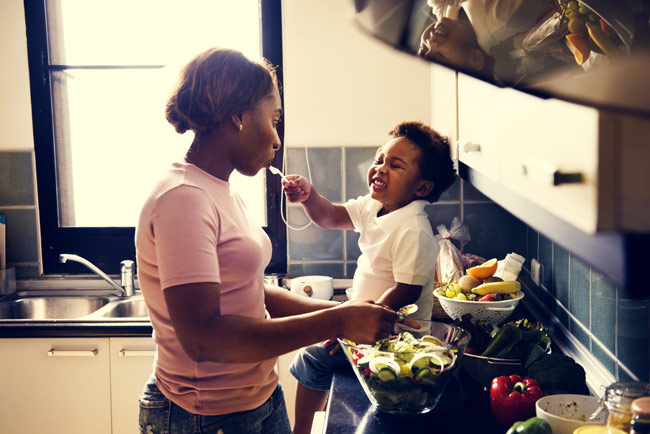 mom and young child in kitchen - healthy foods