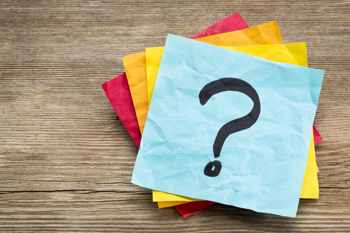 stack of post-it notes with question mark - IOP