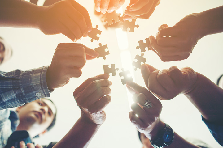 people holding puzzle pieces; unity - aftercare