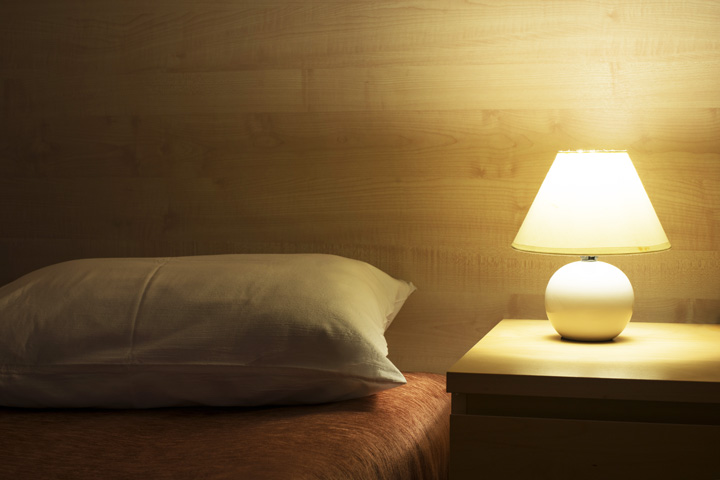 bed and night stand with lamp