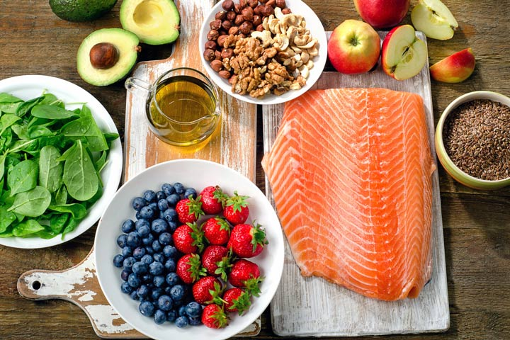 table with fruit, salmon, and avocado - nutrition
