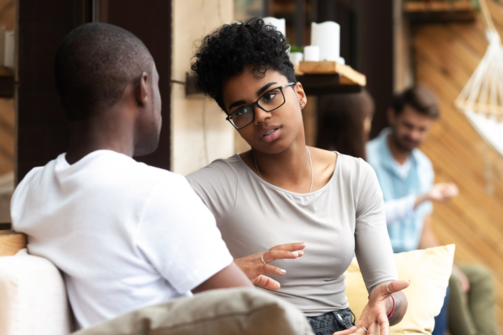 woman having conversation with man - relationships