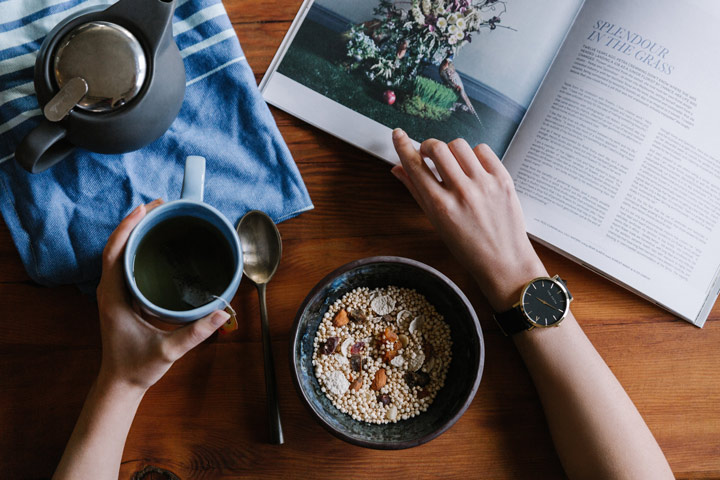 aerial view person eating healthy meal and reading magazine - stress