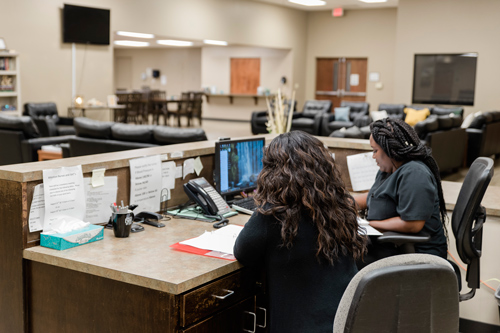 two women working behind desk in day room - Victory Addiction Recovery Center - Louisiana drug and alcohol rehab