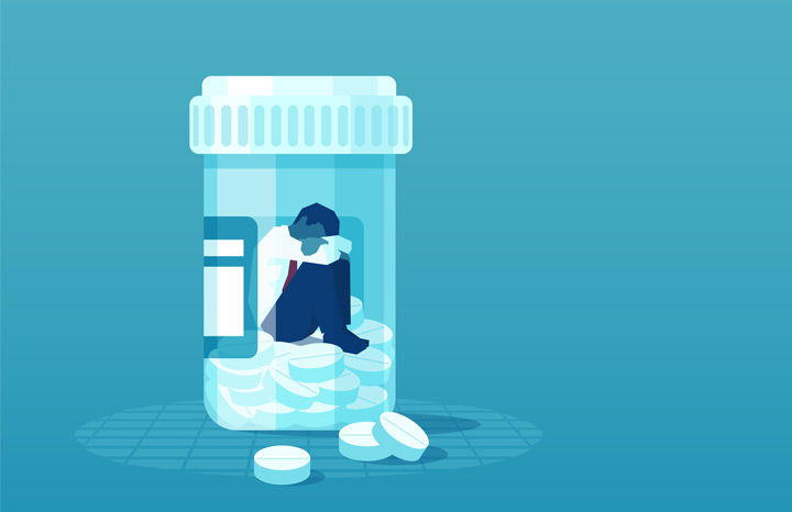 illustration in blue tones of man trapped inside bottle of pills - Xanax addiction