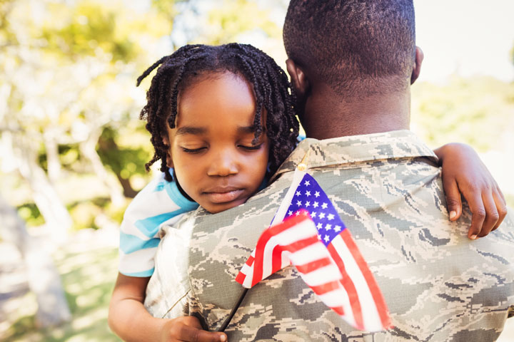 small child hugging their military father - veterans and addiction